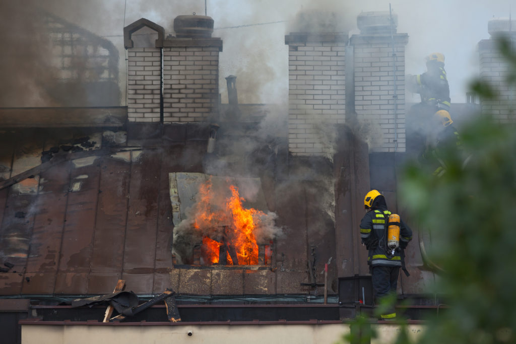 Washington firemen putting  a chimney fire out